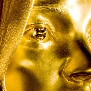 Kate Moss kot zlat kip